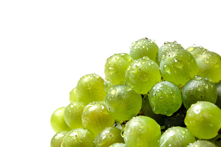 Handful of green grapes with water droplets isolated on white background. Reklamní fotografie
