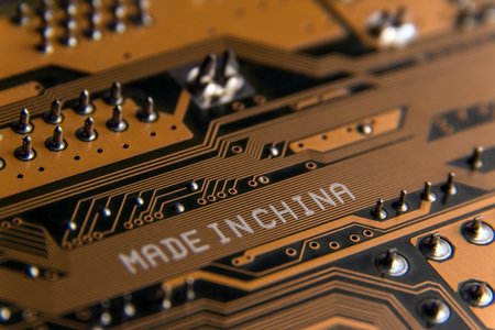 Made in China. Macro of a white inscription on an electrical board.