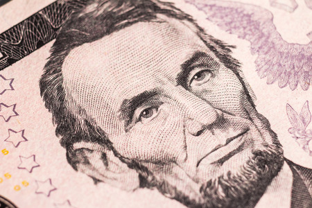 Super macro. Portrait of President Lincoln on a five-dollar bill.