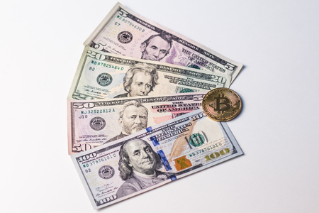 Four portraits of US presidents on dollars and gold bitcoin. White background.