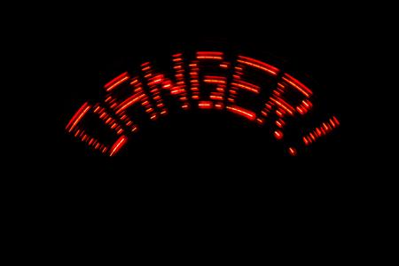 Red LED Danger! inscription of the black background.