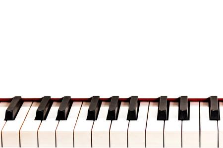 Octaaf zwarte en witte toetsen van een witte vleugel. Ruimte voor de inscriptie. Ontwerp voor een muzikaal concept. Stockfoto - 89585900