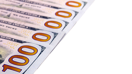 The number one million is laid out of five hundred dollar bills on a white background. Wealth and cash account. Copy space. Close-up. Isolated.