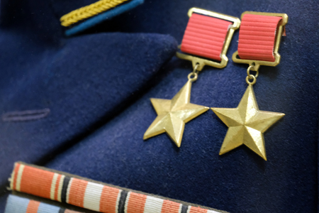 Shallow depth of field. The symbol of the highest degree of distinction between the warrior of the USSR: twice the hero of the Soviet Union. Medals on the blue uniform of the times of the Great Patriotic War.