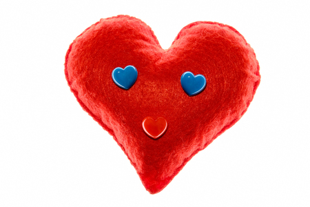 Close-up. Soft red heart. Emotion with blue eyes. A symbol of love and happiness. White background.