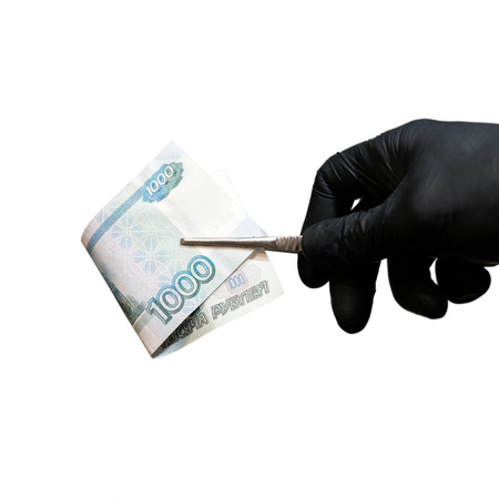 A man holds money in medical gloves. On the white blackground. 스톡 콘텐츠
