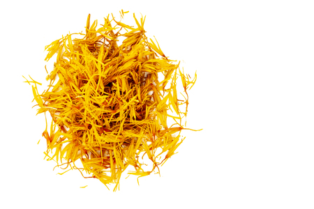 Dried yellow inflorescences of safflower dye lie in the form of a circle. Latin name carthamus tinctorius. Isolated on white background. Copy space. Standard-Bild - 112615677
