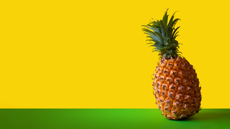 Template for packaging or designer blank banner for pineapple advertising. Ripe sweet exotic fruit on green and yellow background. Clipart for design. Copy space. 스톡 콘텐츠 - 114940459