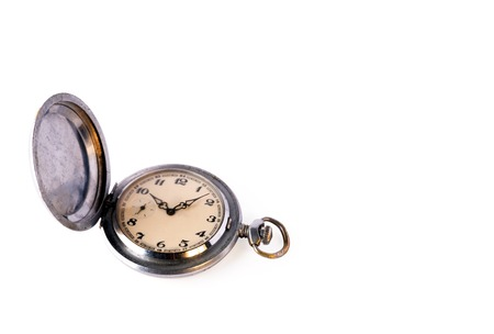 Old retro pocket watch with scratches isolated on a white background. Object for design on the theme of time management or watchmaking. Copy space.