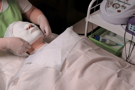 The procedure of rejuvenation and cleansing of the skin in the cosmetology center. Spa treatment for a Muslim woman receiving masks. The girl in the beauty salon in the office in the beauty salon.