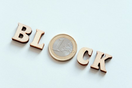 Wooden inscription Block of wooden letters and a silver coin in one Euro. Private Internet access.