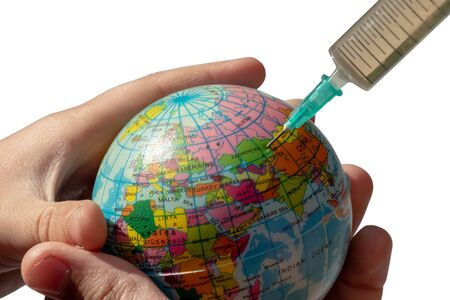 A syringe is plugged into Kazakhstan. Globe in childrens hands. Isolated. The concept of global disease and treatment of the earth, the ecological catastrophe of the planet, the exhaustion of energy. Stock Photo