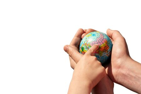 Hands holding the globe on isolated background. The finger of the child points to Russia. Isolate. Copy space.