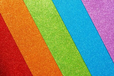 Abstract shiny colorful background. Red, orange, green, blue, purple glitter. A set of designer paper for decoration and design of Christmas, New Year or other holiday pictures. Beautiful packaging material. 写真素材
