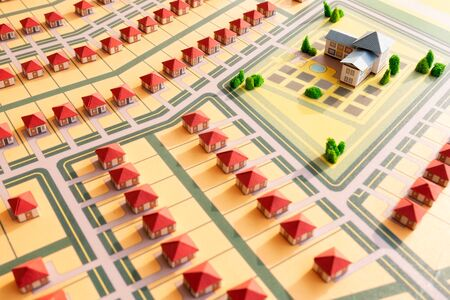 Abstract model of a village or small area of the city made of paper. The draft plan for the construction of a new neighborhood. Urban layout Building.