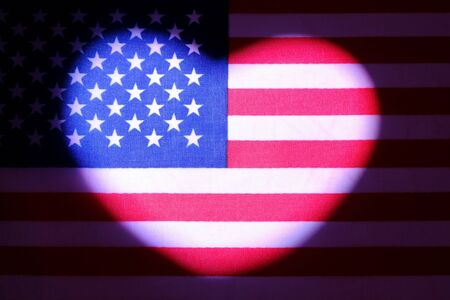 Heart symbol on usa flag. Symbol of patriotism, love and freedom. The concept of American independence and the celebration of Valentine's Day. Dark background.