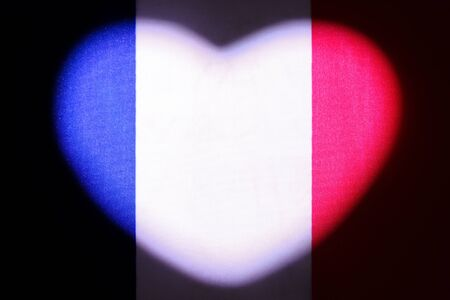 French flag illuminated in the shape of a heart. Symbol for the design and illustration of relationships and feelings. The concept of love, patriotism and independence. Valentine's Day in France. European state.