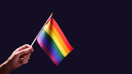LGBT rainbow flag waving on a black background