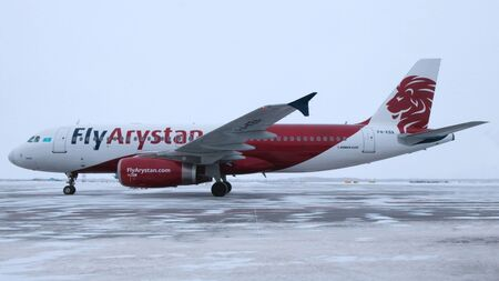 2019-12-18 Kostanay, Kazakhstan. Airbus A320 aircraft is parked at the winter airfield. The first flight of the Kazakhstan airline FlyArystan from Nur-Sultan to Kostanay.