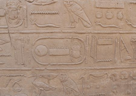 Ancient Egyptian hieroglyphics and reliefs