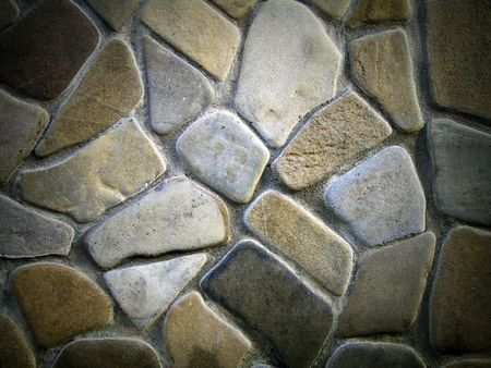 Facing of a wall from large smooth stones, stones background Stock Photo - 6744536