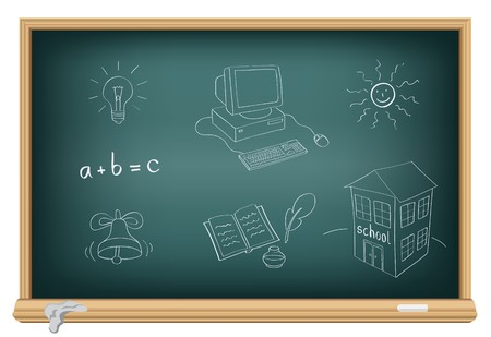 Drawing school subjects by a chalk on the classroom blackboard