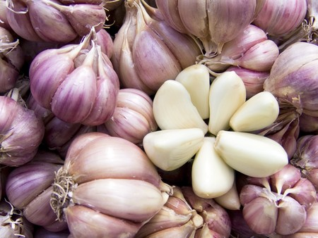Agricultural background, a pile of beautiful cleared garlic