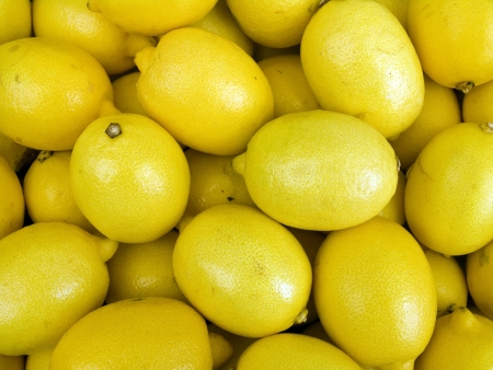 Agricultural background; a pile of beautiful lemons Stock Photo