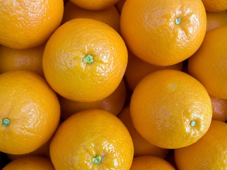 Agricultural background; a pile of beautiful oranges photo