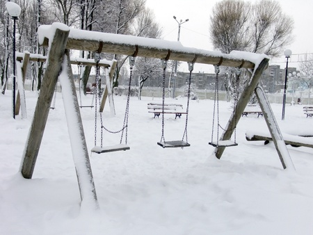 Children playground in winter photo