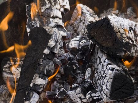 ashy: The firewood burning for cooking grill or barbecue