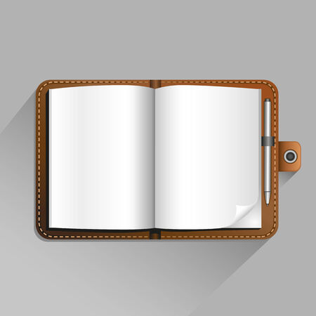 The brown open notebook with pen and top view shadow on the gray background