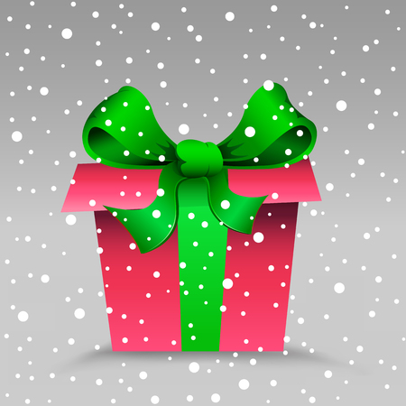 The Christmas gift and snow on the gray background