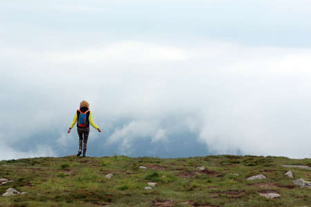 The girl on top of the mountain Hoverla in Ukraine