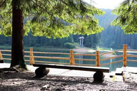Observation area and shore of Lake Synevir in the Carpathian Mountain Stock Photo