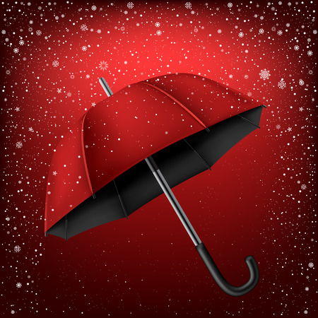 Red and black umbrella on snow background. Christmas and New Year theme