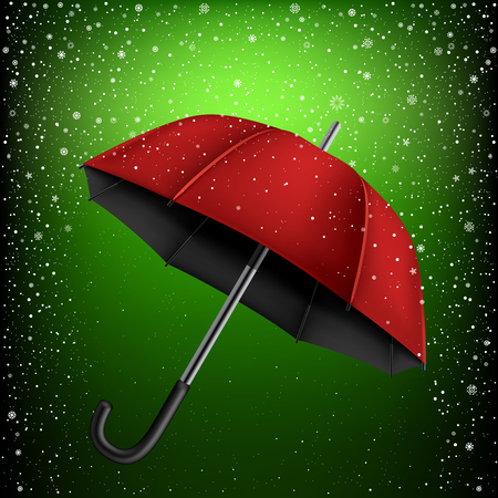 disclosed: Red and black umbrella on green snow background. Christmas and New Year theme