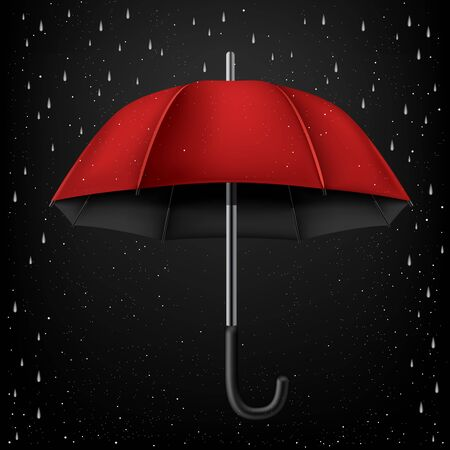 disclosed: The opened red umbrella on rainy dark background
