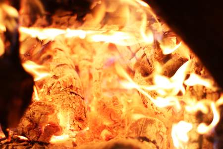 Burning log fire in night heat fireplace. Closeup flame. Barbecue coal blazing Stock Photo