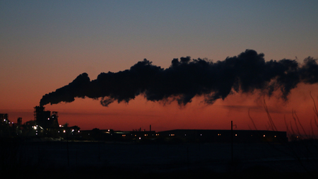 Black smoke silhouette on red sunset. Ecology industry environment factory pollution
