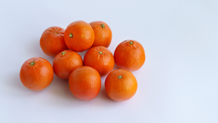 Pile of mandarin on white background. Food fruit Stock Photo