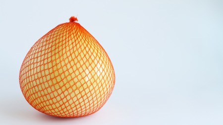 Citrus maxima. Pomelo fruit on white background. Pomela in orange grid Stock Photo