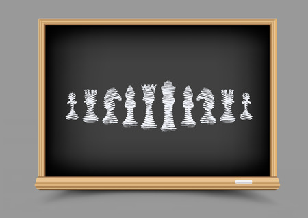White drawing chess figures set collection on black education blackboard.