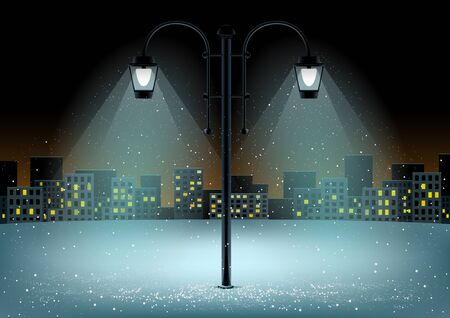 Electric pillar and falling snow in lamps lights. Christmas snowflakes falls on night city background Stock Photo