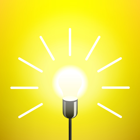 Retro electric light bulb on yellow background.