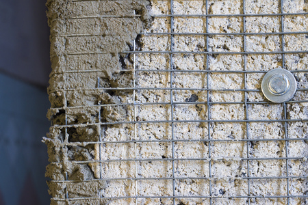 Wall reinforcement with metal mesh. Building wall corner repair. Architecture lattice base construction