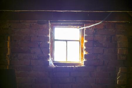 Sunlight outside old wooden window, darkness inside