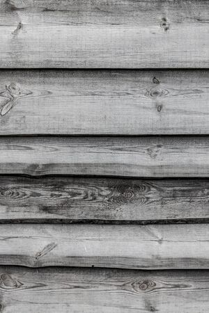 Gray wooden boards vertical background. Wall floor or fence exterior design. Natural wood material backdrop
