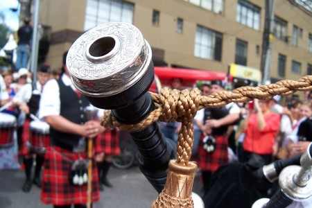 bagpipe: Bagpipe player at a street festival in So Paulo Stock Photo