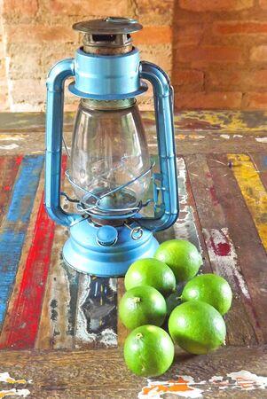 kerosene: blue kerosene lamp and freshly collected limes